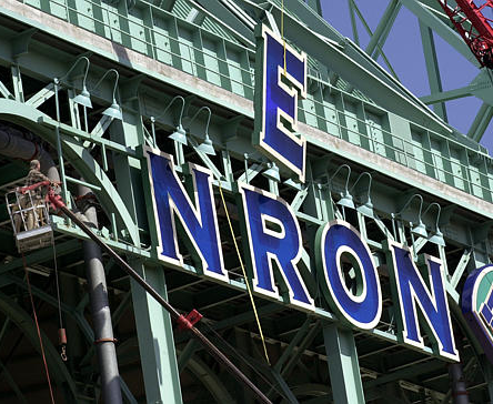 Todd Norris, of Neon Electric Corp., left, watches as the E on one of the final remaining Enron Field signs outside the formely named ballpark Tuesday, March 26, 2002 in Houston.